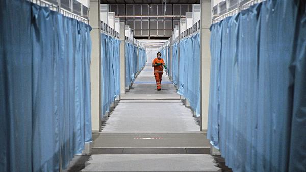 A custodian walks down the corridor of a field hospital set up for COVID-19 patients in Rio de Janeiro. Brazil has emerged as a new hot spot of the coronavirus, which in a span of just three months has reached virtually every country in the world.