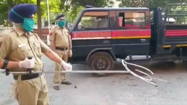 Police in Chandigarh, India, tweeted a video of officers using a pole with a movable, two-pronged claw for catching a suspect around the waist.