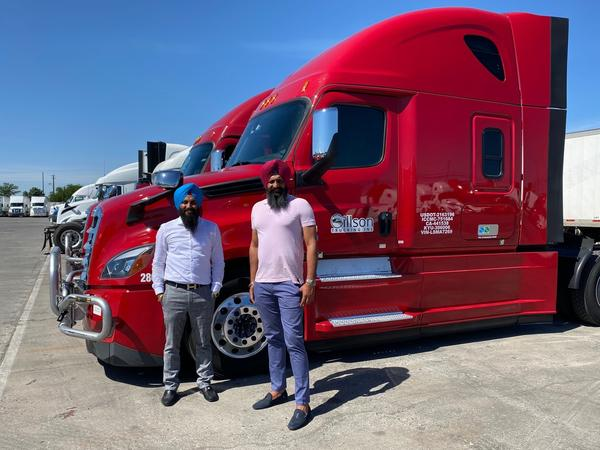 Gillson Trucking co-owner Harsimran Singh (right), seen with his partner Bikramjit Singh, says his trucks that haul produce are mostly idle because restaurants have shut down.