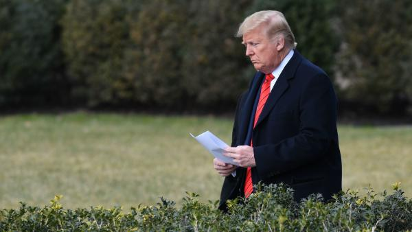 President Trump walks outside the White House in January. The president received intelligence briefings on the coronavirus twice that month, according to a White House official.