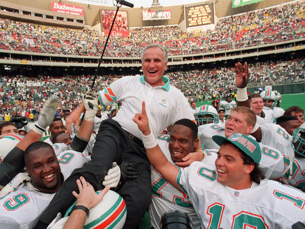 Miami Dolphins coach Don Shula is carried on his team's shoulders in 1993 after his 325th victory, against the Philadelphia Eagles in Philadelphia.
