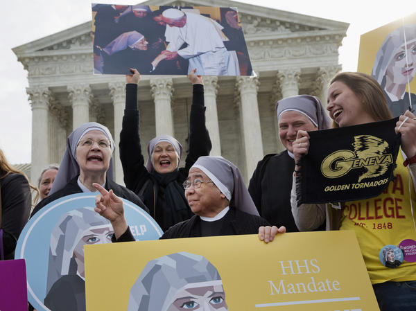 Nuns with the Little Sisters of The Poor, including Sister Celestine, left, and Sister Jeanne Veronique, center, rally outside the Supreme Court in Washington on March 23, 2016.