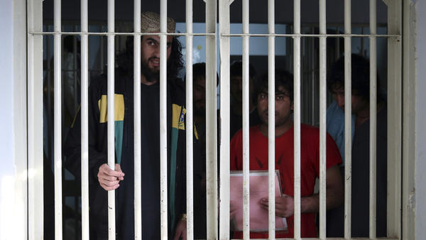 Jailed Taliban are seen inside the Pul-e-Charkhi prison in Kabul in December. Prisoner release is a key pillar of the U.S.-Taliban agreement.