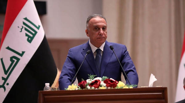 Mustafa al-Kadhimi speaks to Parliament in Baghdad on Thursday. Iraq's former spy chief was sworn in early Thursday as prime minister after weeks of tense political negotiations as the country faces a severe economic crisis spurred by the coronavirus pandemic.