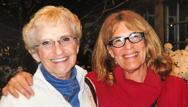 Jackie Stockton (left) and daughter Alice Stockton-Rossini at the Philadelphia Flower Show in March 2019. The two women have recovered from COVID-19 after an outbreak hit their New Jersey community.