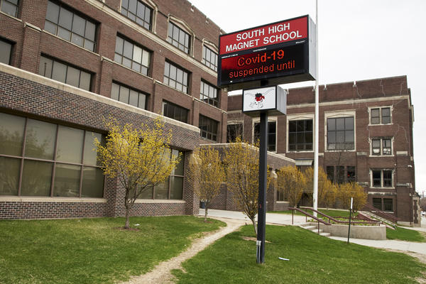 An electronic sign at South High Magnet School in Omaha, Neb., announced on April 2, that school is suspended until further notice, due to the coronavirus.