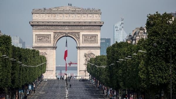 The iconic Champs-Élysées and its Arc de Triomphe stand eerily empty before V-E Day ceremonies Friday in Paris. The 75th anniversary of the end of World War II in Europe, which was expected to be a time for vast parades and celebration, instead unfolded in the shadow of France's coronavirus lockdown.