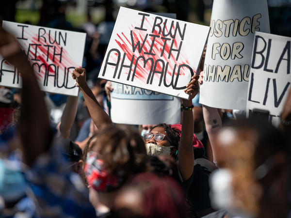 Demonstrators protest the shooting death of Ahmaud Arbery at the Glynn County Courthouse on May 8 in Brunswick, Ga.