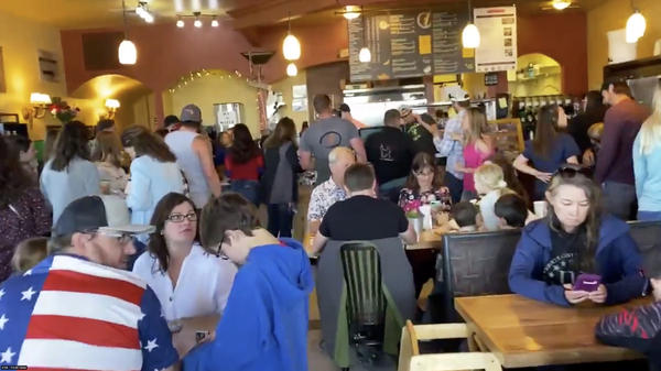 Large numbers of customers celebrate Mother's Day at C&C Coffee and Kitchen in Castle Rock, Colo., after the restaurant opened its dining room in defiance of state orders.