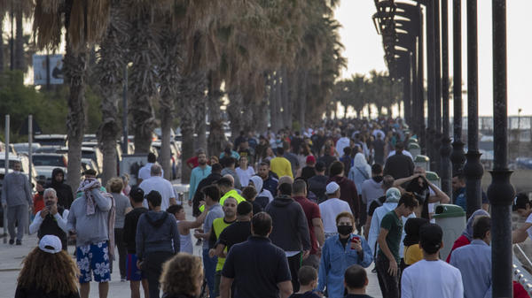 People walk and exercise at a promenade along the Mediterranean Sea during the coronavirus pandemic in Beirut on May 3. The Lebanese government has decided to reimpose restrictions after a rise in cases.
