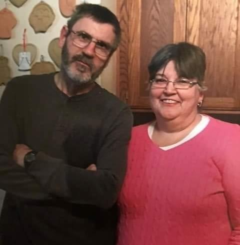 """George """"Bernie"""" Robare, left, died of COVID-19 on May 11. He is the first prison employee in Kansas known to have died of the virus. He is pictured with his wife, Susan Robare of Bonner Springs."""