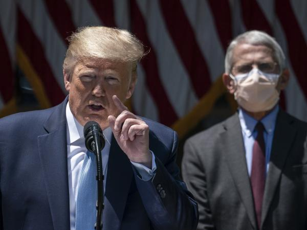 A masked Dr. Anthony Fauci joins President Trump as he delivers remarks about the coronavirus vaccine development Friday in the Rose Garden.