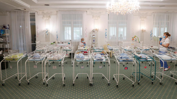 Nurses and newborns in Hotel Venice, a facility owned by BioTexCom clinic in Kyiv, Ukraine, on Thursday. Dozens of babies born to surrogate mothers are stranded in Ukraine as the coronavirus restrictions prevent  foreign parents from collecting them.