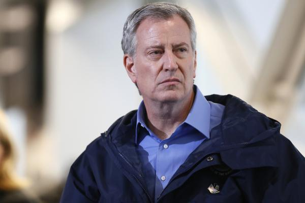 """New York City Mayor Bill de Blasio announced today that the NYPD will no longer require people to wear masks in public, unless the absence of a mask presents a """"serious danger."""" He's seen here on March 31."""