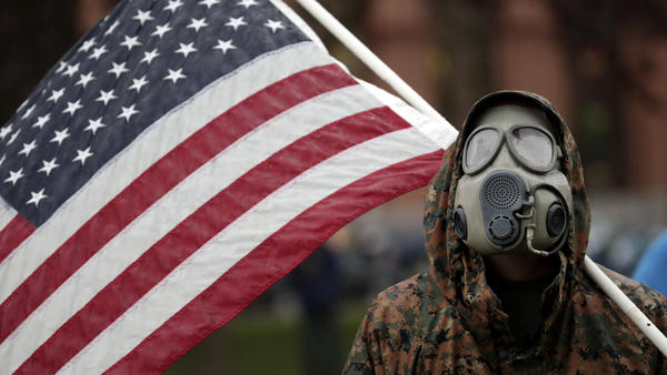 A protester attends a demonstration over Michigan's coronavirus restrictions on Thursday at the state Capitol in Lansing.