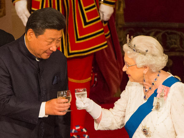"Chinese President Xi Jinping with Queen Elizabeth II during a state banquet at Buckingham Palace during Xi's state visit to Britain in October 2015. During Xi's visit, the queen hailed a new ""golden era"" in relations between the two countries."