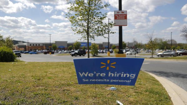 A Walmart store in Maryland seeks new workers during the coronavirus pandemic. The big retailer says it hired 235,000 new staffers to keep up with demand.