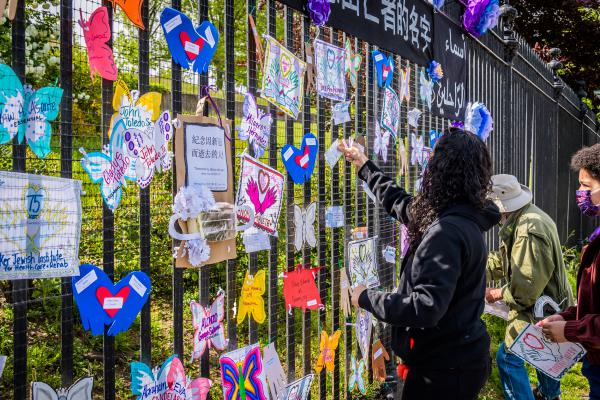 A volunteer artist sets up a memorial May 20 in Brooklyn. Artists and volunteer organizers across New York City put up memorials throughout the five boroughs to honor those who died of COVID-19.