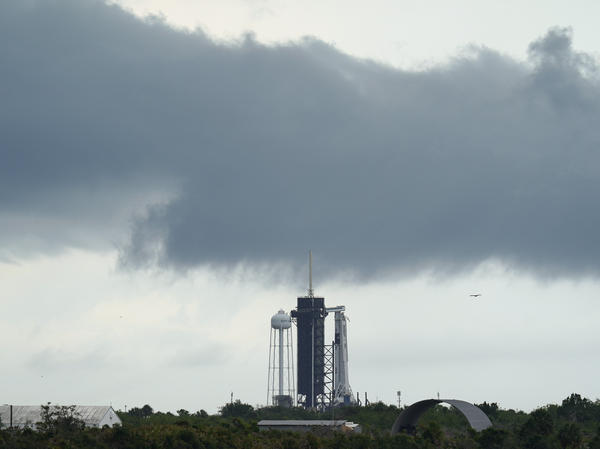 Clouds pass over the SpaceX Falcon 9, with the Crew Dragon spacecraft on top of the rocket on Launch Pad 39-A on Wednesday at Kennedy Space Center in Cape Canaveral, Fla.