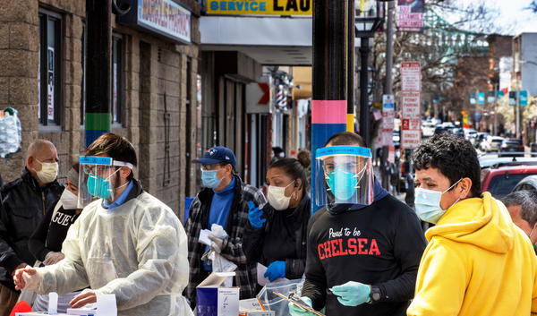 People line up in mid-April in Chelsea, Mass., to get antibody tests for the coronavirus that causes COVID-19.