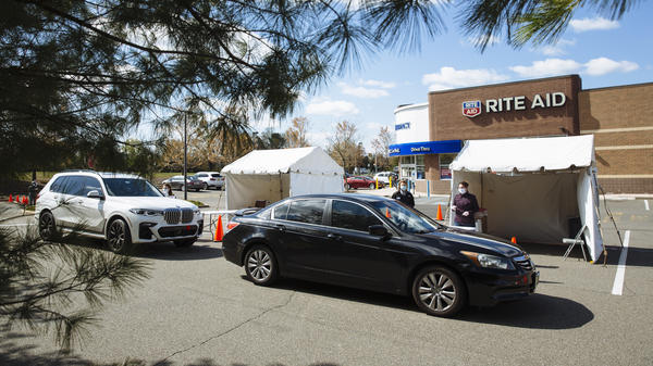 People in cars arrive at a drive-up COVID-19 testing site outside a Rite Aid in Toms River, N.J., on April 22. About 3% of Rite Aid stores are offering testing for the virus.
