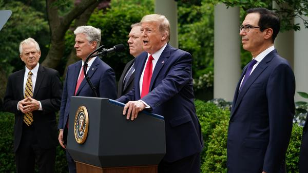 President Trump gives remarks Friday on China in the Rose Garden. Alongside him are trade adviser Peter Navarro, from left, national security adviser Robert O'Brien, Secretary of State Mike Pompeo and Treasury Secretary Steven Mnuchin.