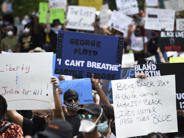 Demonstrators gather Friday in Atlanta's Centennial Olympic Park, one of several protests organized in cities across the United States.