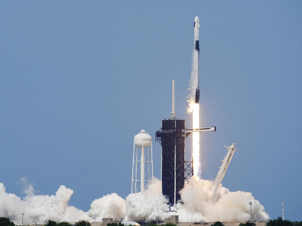 A SpaceX Falcon 9, with NASA astronauts Doug Hurley and Bob Behnken in the Dragon crew capsule, lifts off from Pad 39A at the Kennedy Space Center in Cape Canaveral, Fla., on Saturday.