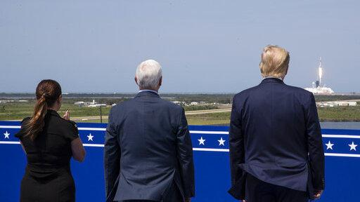 President Trump, Vice President Pence and Karen Pence view the SpaceX flight to the International Space Station at Kennedy Space Center on Cape Canaveral, Fla., on Saturday.