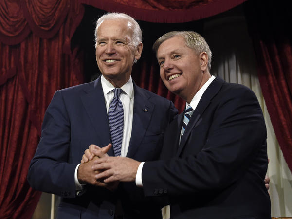 Vice President Joe Biden shares a laugh with Sen. Lindsey Graham, R-S.C., back in 2015. Graham's Judiciary Committee is beginning an investigation with links to Biden and his family.