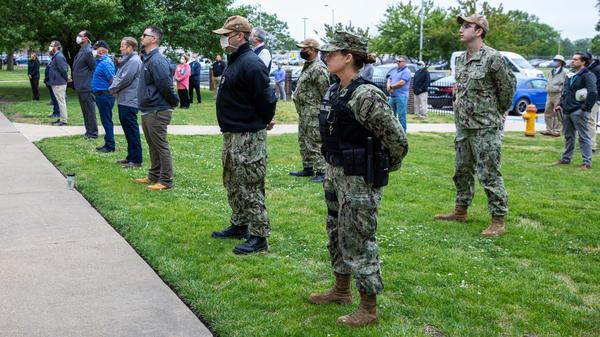 Sailors and civilians at the Norfolk Naval Shipyard follow social distancing requirements as they attend a Memorial Day ceremony May 19.