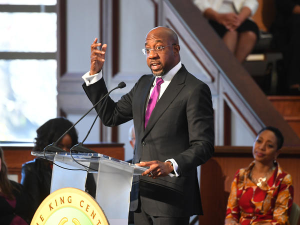 The. Rev. Raphael G. Warnock, senior pastor of Atlanta's Ebenezer Baptist Church, speaks at a January 2019 service to remember the Rev. Martin Luther King Jr.'s legacy.