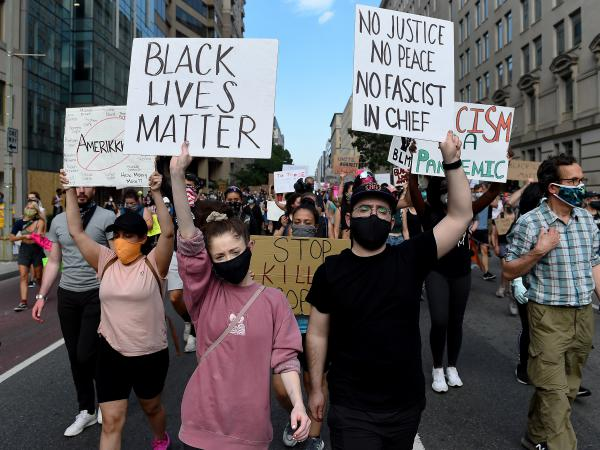 Demonstrators march near the White House on Thursday, protesting the death of George Floyd in Minneapolis police custody.
