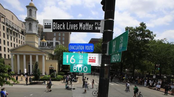 "A new street sign sits above an intersection outside St. John's Church in Washington, D.C., where President Trump arranged a photo-op this week. Mayor Muriel Bowser says, ""The section of 16th [Street] in front of the White House is now officially 'Black Lives Matter Plaza.' """