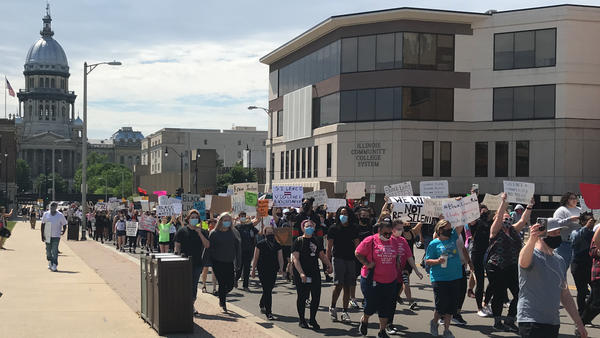 Protesters march on Capitol Avenue in Springfield Monday against police brutality. The rally and march were organized by young people.