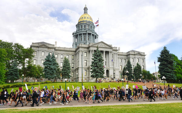 """Protesters chanted """"no justice, no peace,"""" """"George Floyd"""" and """"Black lives matter"""" as they marched past the Capitol building on Thursday."""