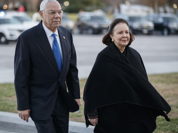 Former Secretary of State Colin Powell, seen here in December 2018 with his wife, Alma, said he would vote for Joe Biden.