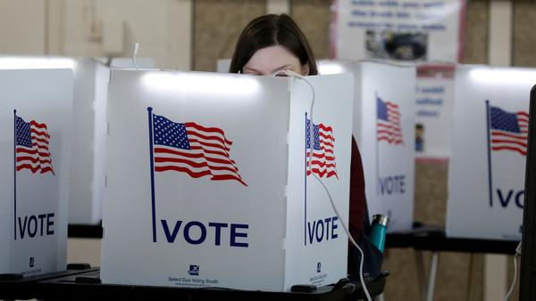 """People vote in Detroit during the March 10 Michigan primary. A new survey has identified a group of persuadable voters dubbed """"guardian women"""" who could decide which party wins key states like Michigan and the election."""