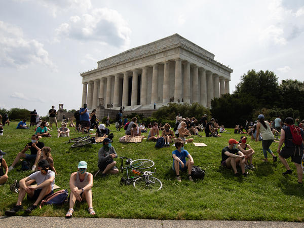Thousands of people gather Saturday near the Lincoln Memorial in Washington, D.C., following a demonstration at the Dirksen Senate Office Building to protest police brutality.