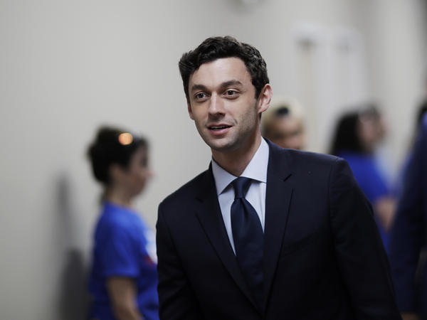 Jon Ossoff leaves a campaign office during a 2017 race after meeting with supporters in Marietta, Ga. Ossoff will face Republican Sen. David Perdue in November.