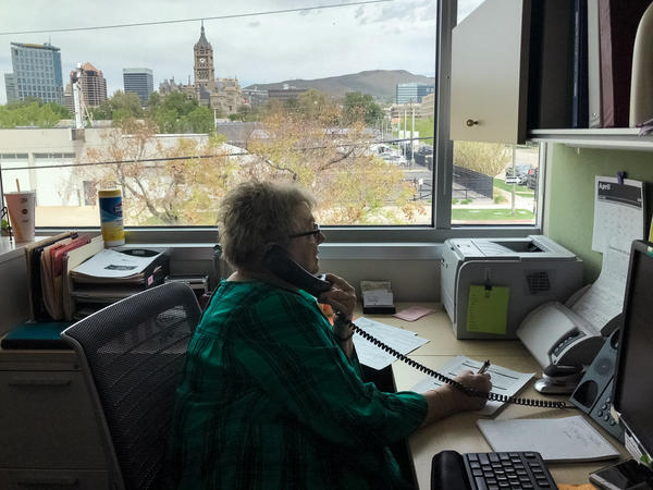 Debbie Sorensen, an infectious disease nurse with Salt Lake County Public Health Department in Salt Lake City, talks by phone with a woman who recently tested positive for the coronavirus. Sorensen is one of the county's 130 contact tracers aiming to slow the spread of COVID-19.