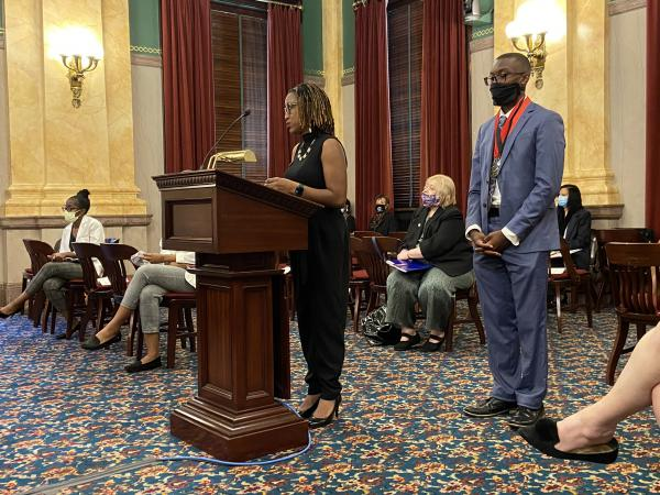 Taraja Shephard Allen and her son Daylen, both of Columbus, testify in support of the resolution before the Senate Health and Medicaid Committee.