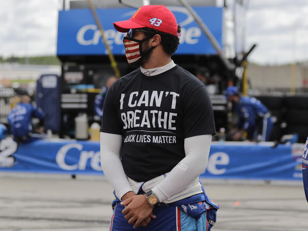 """Bubba Wallace wears an """"I Can't Breathe, Black Lives Matter"""" shirt before a NASCAR Cup Series auto race Sunday at Atlanta Motor Speedway."""