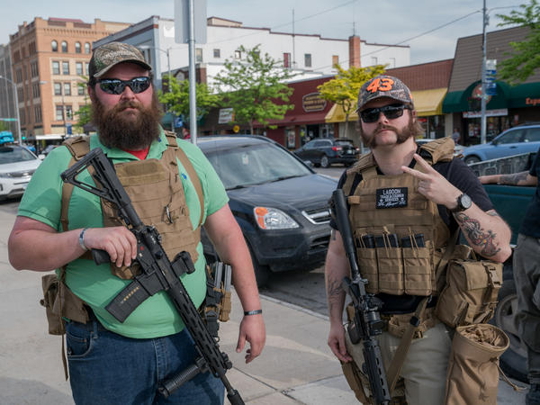 Max Metcalf (right) and Justin, who wouldn't give his last name due to safety and employment concerns, say they are at a rally in Missoula, Mont., to protect protesters from violent agitators.