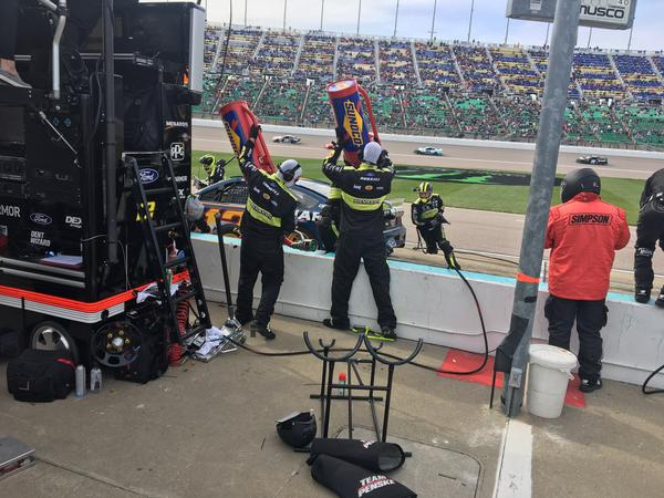 Emporia native Chris Tidwell (holding the gas can on the left) served on the crew of Ryan Blaney during the fall 2019 Cup race at Kansas Speedway.