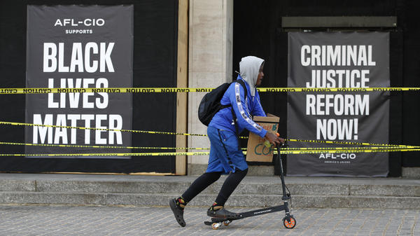 "Signs outside the boarded-up entrance to AFL-CIO headquarters in Washington, D.C., read ""AFL-CIO Supports Black Lives Matter"" and ""Criminal Justice Reform Now!"""