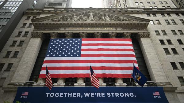 Stocks fell sharply Thursday after coronavirus cases spike and the Federal Reserve warned that the recovery will take a long time.