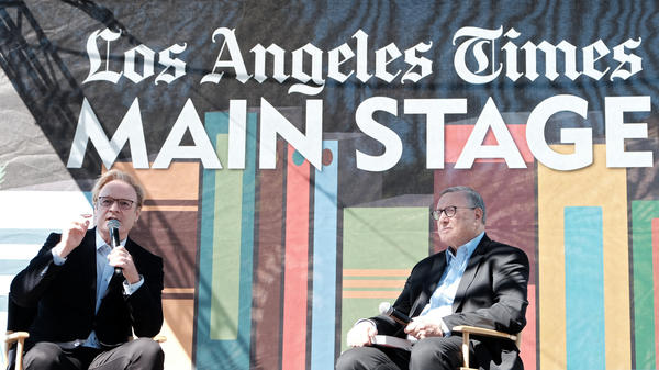 <em>LA Times</em> Executive Editor Norman Pearlstine (right) listens to Lawrence O'Donnell at the 2019 Los Angeles Times Festival of Books in April 2019.