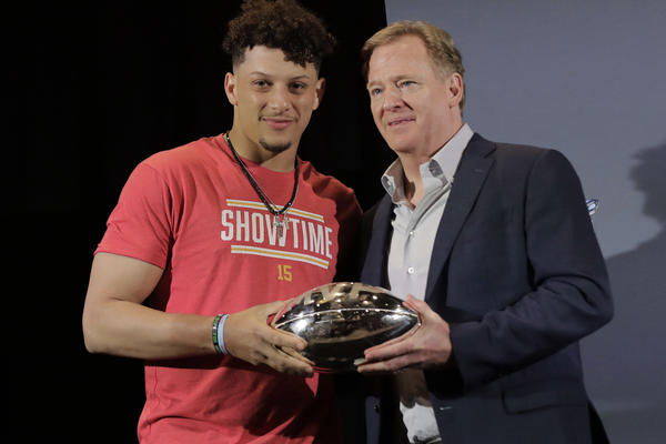 FILE - In this Feb. 3, 2020, file photo, Kansas City Chiefs quarterback Patrick Mahomes, left, holds the MVP trophy with NFL Commissioner Roger Goodell before speaking at a news conference in Miami. After leading the Chiefs to their first Super Bowl championship in five decades, Mahomes is finally eligible to sign a contract extension this off-season.  (AP Photo/Brynn Anderson, File)