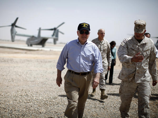 Then U.S. Secretary of Defense Robert Gates walks from an Osprey aircraft after landing at Forward Operating Base Dwyer on June 5, 2011 in Kandahar province, Afghanistan.